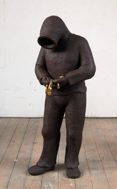 Xiliphus 2010 fired black clay H: 140 cm private collection Lieshout
